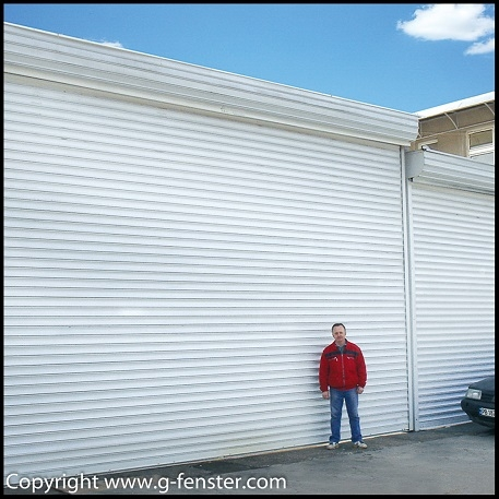 Security shutters with windproof slats