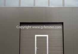 Industrial sectional door pass door